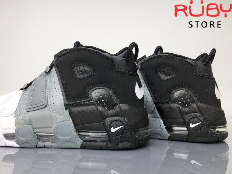 Phần gót 2 chiếc Giày Nike Uptempo Tri-Color 3 màu trên sàn nhà